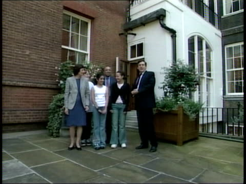 investment in public services announced ITN ENGLAND London Downing Street Gordon Brown MP showing school children around garden as joined by Estelle...