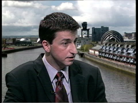 government spin shake up; int douglas alexander mp interview sot - structure announced today is step forward - douglas alexander stock videos & royalty-free footage
