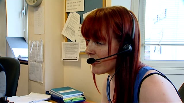 Government to announce plans to tackle the issue of female genital multilation T24061331 Woman with headset speaking to NSPCC helpline caller SOT...