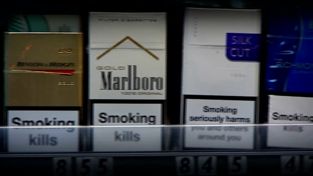 government to ban branding on cigarette packets; england: london: int packets of cigarettes on display in shop to australian cigarette packet which... - sachet stock videos & royalty-free footage