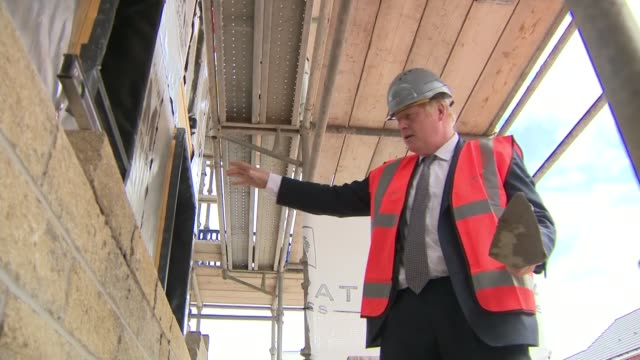government to ease planning rules: boris johnson building site visit; england: cheshire: ext tilt up boris johnson mp along at building site with... - scrubs stock videos & royalty-free footage