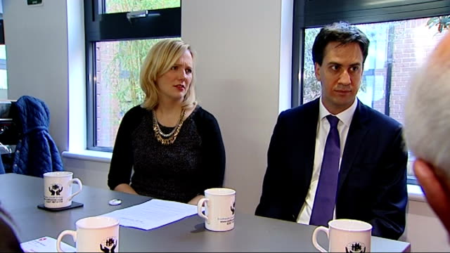 Government to impose cap on payday loans Date Location Unknown INT Shots of Ed Miliband MP and Stella Creasy MP at table during visit