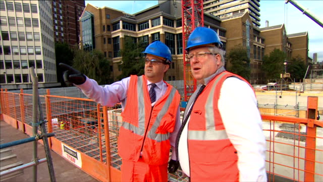 government to impose new cap on rail fares london bridge ext patrick mcloughlin mp chatting to worker on construction site of london bridge station... - patrick mcloughlin stock videos and b-roll footage