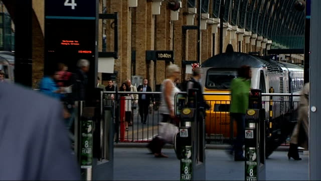 government to impose new cap on rail fares london king's cross passengers towards after arrival by platforms '8' and '7' people along on platform... - man and machine stock videos & royalty-free footage