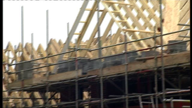 government to tackle problem of empty homes lib guildford frame of partially built house construction worker using cutting tool david cameron mp and... - guildford stock videos and b-roll footage