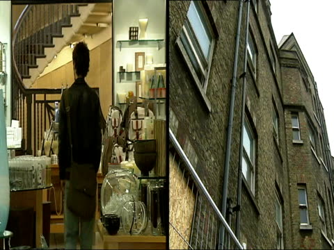Government to tackle problem of empty properties in London ITN London EXT i/c beside derelict building Young people along in home store/ derelict...
