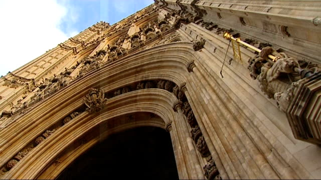 stockvideo's en b-roll-footage met government tries to pass emergency phone and internet data legislation england london ext mid shot houses of parliament low angle view of houses of... - bare tree
