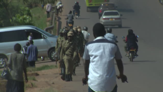 government troops patrolling the streets in kampala uganda - kampala stock videos & royalty-free footage