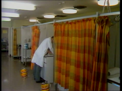 government tv ad campaign; england: london: padington: int blood test carried out blood in tubes doctor medical records dept examination areas of... - clinic stock videos & royalty-free footage