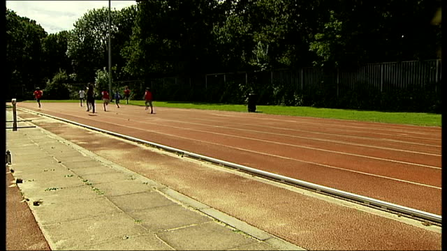 government under pressure over school sports fields selloff england london tooting ext anonymous shots of children sprinting on athletics running... - hurdling horse racing stock videos and b-roll footage