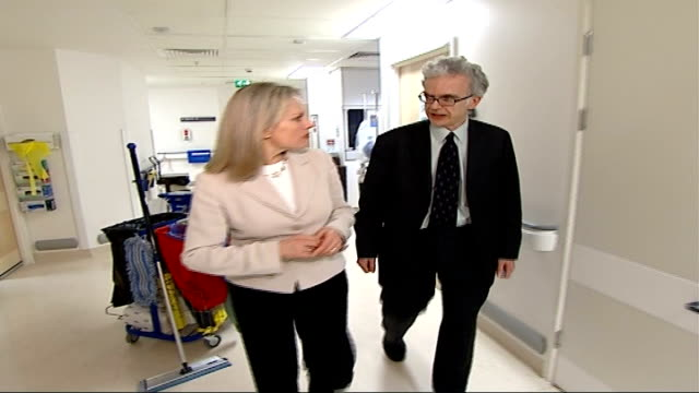 government unlikely to meet mrsa target; england: london: int reporter along talking to dr peter wilson dissolve to - staphylococcus aureus stock videos & royalty-free footage