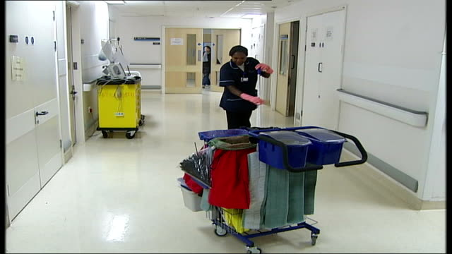 government unlikely to meet mrsa target; england: london: university college london hospitals trust: int hospital cleaner sweeping floor of corridor - staphylococcus aureus stock videos & royalty-free footage