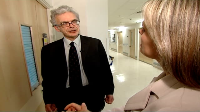 government unlikely to meet mrsa target reporter pressing hand rub dispenser on wall pan wilson interview with reporter in shot sot on hand cleaning... - mrsa stock videos and b-roll footage