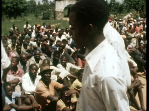 Government uses touring troupe to counter guerilla raids RHODESIA MS Talking to white man MS Soldiers walk about MS People towards MS People off...
