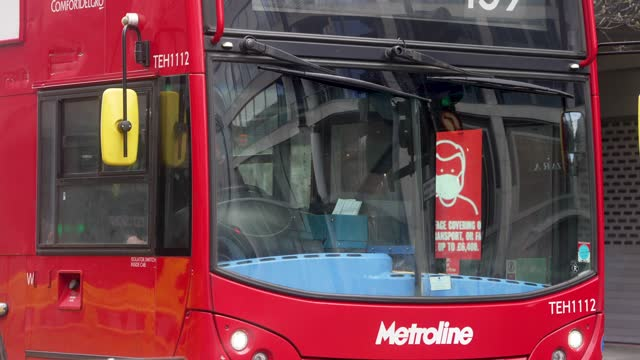 government warning electronic posters on a bus stop on a quiet oxford street, as some restrictions are lifted allowing people to mix in two's and eat... - bus stock videos & royalty-free footage