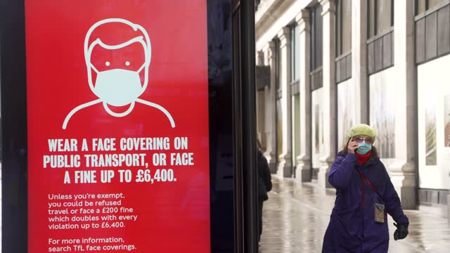 government warning posters asking people to wear face coverings on display on a quiet oxford street, as some restrictions are lifted allowing people... - slow stock videos & royalty-free footage