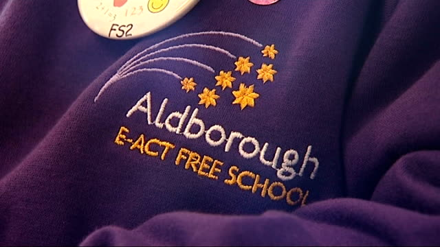 government's first flagship free schools open int close shot of 'aldborough eact free school' name on child's sweatshirt uniform empty classroom wide... - sweatshirt stock videos & royalty-free footage