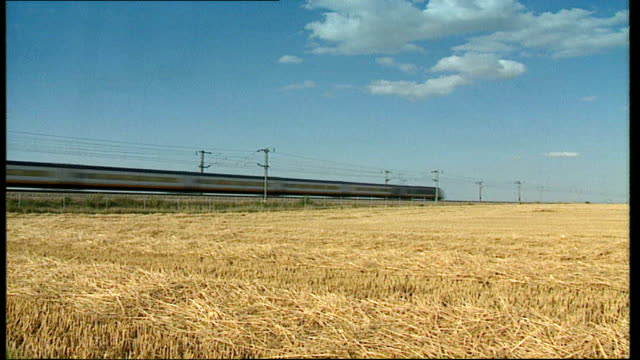 government's 'fiscal rules' attacked by opposition tx kent ext various shors of eurostar train along though countryside past fields emerging from... - 2007 stock videos and b-roll footage