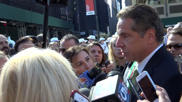 governor andrew cuomo asked by reporter about new jersey transit train crash in hoboken's terminal / annual columbus day parade on october 10 2016 on... - andrew cuomo stock videos and b-roll footage