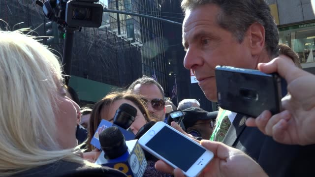 governor andrew cuomo responds to question from reporter about the donald trump tape during the annual columbus day parade on october 10 2016 on 5th... - andrew cuomo stock videos and b-roll footage