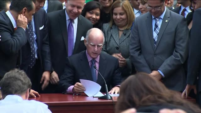 governor brown signs bill ab60 allowing undocumented immigrants to attain drivers licenses on october 03 2013 in los angeles california - undocumented immigrant stock videos & royalty-free footage