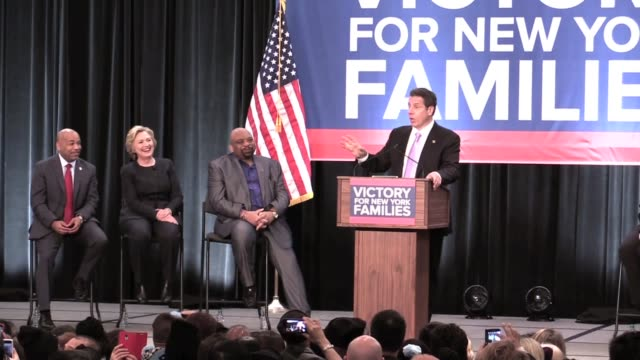 governor cuomo at labor rally day he signed $15 minimum wage bill at javits center fight for 15 with hillary clinton on stage references trump's wall... - andrew cuomo stock videos and b-roll footage