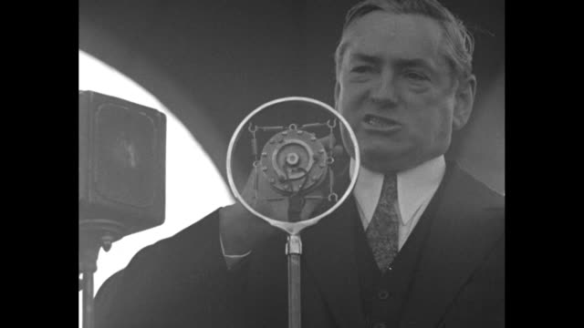 vídeos de stock, filmes e b-roll de governor james michael curley steps to microphones in gazebo / large crowd of men / sot curley gives impassioned speech about threat of japanese... - gazebo