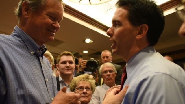 Governor of Wisconsin Scott Walker campaigns in Cedar Rapids Iowa on April 24th 2015 Shots Close up shot of Scott Walker speaking with a voter