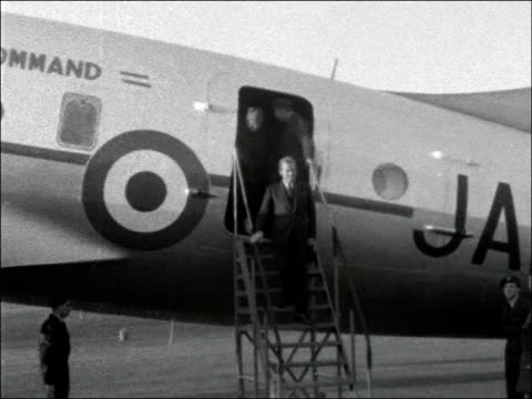 governor sir john harding arrives in nicosia cyprus nicosia airport ext raf plane arriving / ms armed raf guards at airport / mls field marshal sir... - john harding stock videos and b-roll footage