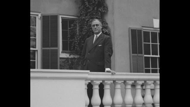 "governor-elect franklin d. roosevelt speaks from the veranda of his home ""springwood""; he casually leans one arm on the balcony railing as he speaks,... - governor stock videos & royalty-free footage"
