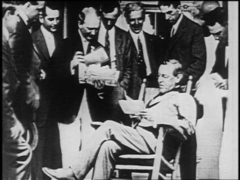stockvideo's en b-roll-footage met governorelect woodrow wilson in chair surrounded by friends examining election returns - woodrow wilson