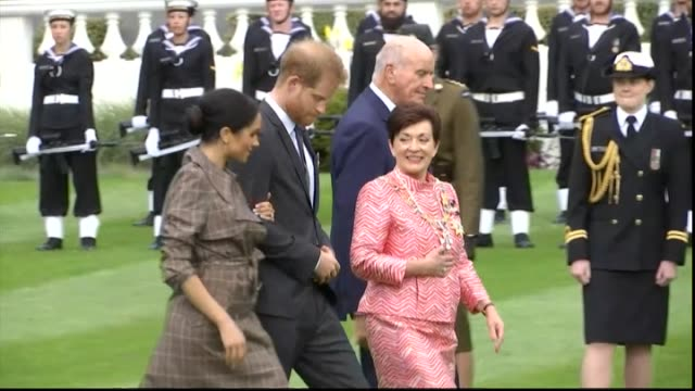GovernorGeneral Dame Patsy Reddy escorts Prince Harry and Meghan Duke and Duchess of Sussex across Government House lawn during Maori welcome in...