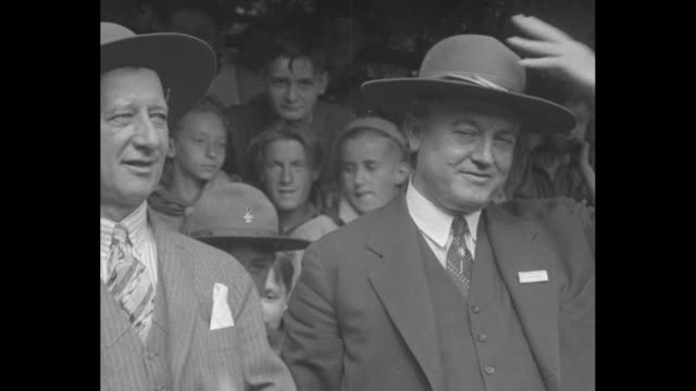 governors al smith of new york and john martineau of arkansas and others with hands raised taking boy scout oath during visit to bear mountain camp... - boy scout stock videos & royalty-free footage