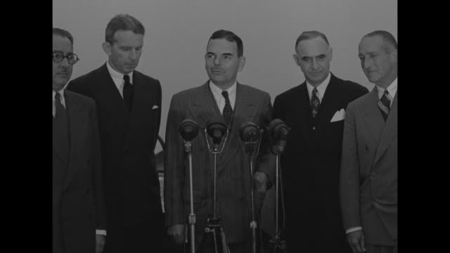 governors and other officials standing in group looking out from atop rockefeller center / governors and two other men turn towards camera from left... - lucius d. clay stock videos and b-roll footage
