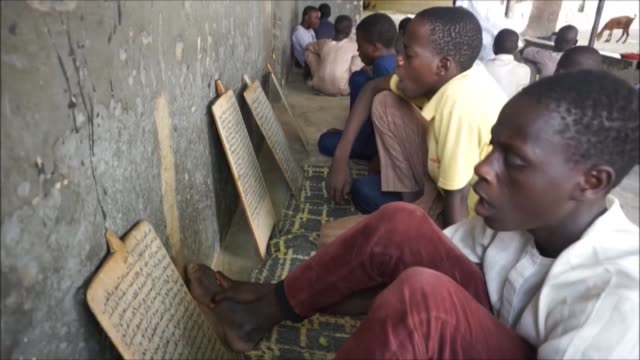 vídeos de stock, filmes e b-roll de governors of 19 states across northern nigeria ban informal islamic madrassa schools where students are taught the koran but have to beg on the... - madressa