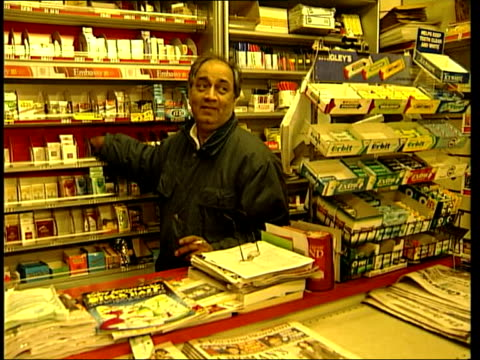 vidéos et rushes de govt plans to raise minimum age for buying cigarettes itn newsagent selling cigarettes to customer / sign saying it is illegal to sell tobacco to... - vendre