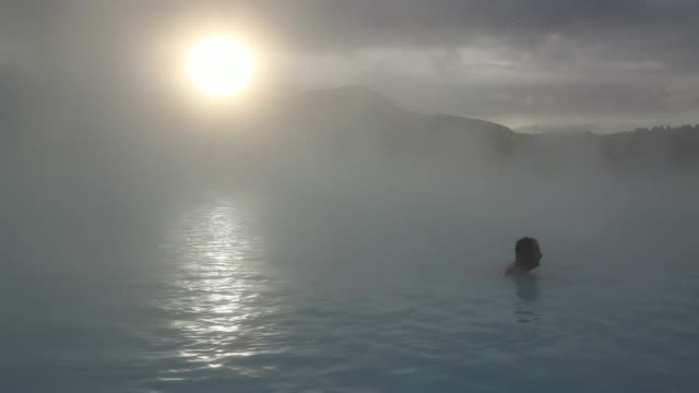 Gowns and towels hang on hooks at the Blue Lagoon geothermal spa as steam rises in Grindavik Iceland on Friday Nov 8 Various shots tourists bathe in...