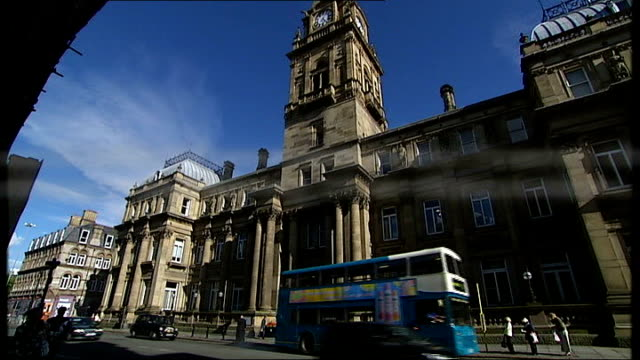 gps thought to be making extra money from outsourcing; central liverpool: municipal buildings: ext graphicised seq general views of building / quote... - outsourcing stock videos & royalty-free footage