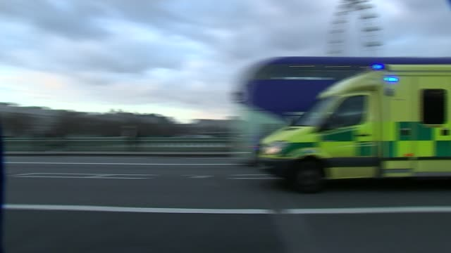 gps urged to extend opening hours to reduce pressure on ae departments england london ext ambulance towards with blue lights flashing and sirens pan... - siren stock videos and b-roll footage