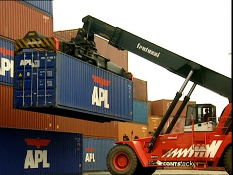Grabber truck lifts APL container on to stack, Container Terminal, Southampton, UK