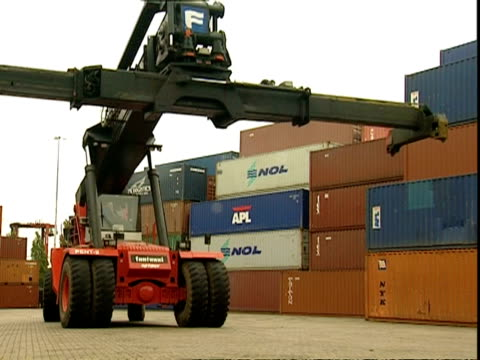 Grabber truck moves around in container park, Container Terminal, Southampton, UK