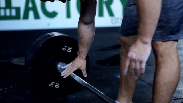 Grabbing the gym bar