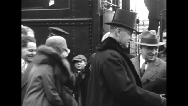 grace coolidge disembarks from rear platform of train as her husband, calvin coolidge, doffs his top hat and follows her; spectators look on as the... - top hat stock videos & royalty-free footage