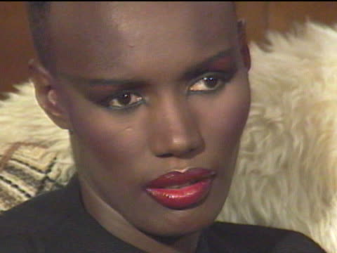 vídeos de stock e filmes b-roll de grace jones began modeling in new york city and emigrated to paris where her unique look became popular among the jet set / returning to the states... - povo jamaicano