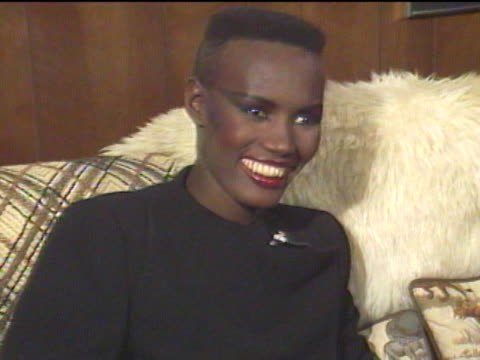 stockvideo's en b-roll-footage met grace jones began modeling in new york city and emigrated to paris where her unique look became popular among the jet set / returning to the states... - jamaicaanse etniciteit