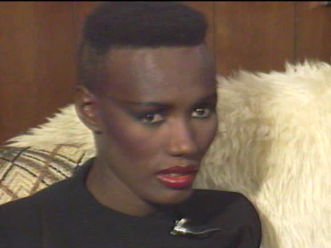 grace jones began modeling in new york city and emigrated to paris where her unique look became popular among the jet set / returning to the states,... - jamaican ethnicity stock videos & royalty-free footage