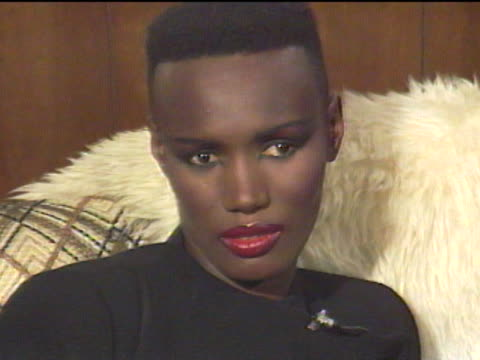 grace jones began modeling in new york city and emigrated to paris where her unique look became popular among the jet set / returning to the states... - jamaican ethnicity stock videos & royalty-free footage