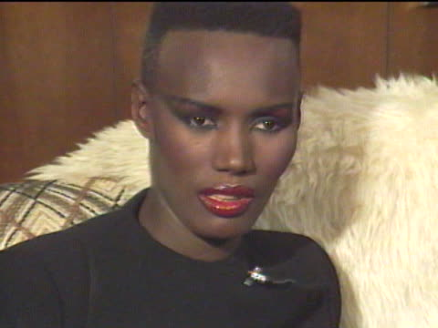 grace jones began modeling in new york city and emigrated to paris where her unique look became popular among the jet set / returning to the states,... - darstellender künstler stock-videos und b-roll-filmmaterial
