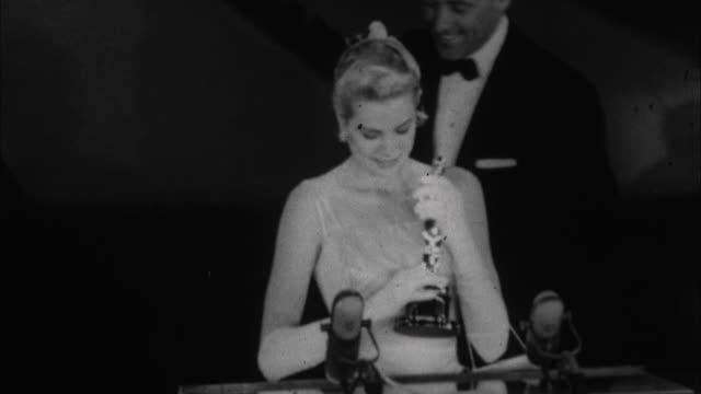 Grace Kelly accepting Oscar and saying thankyou with all her heart to those that made it possible / Los Angeles California USA