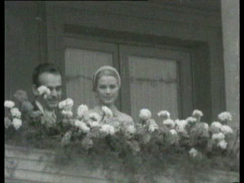 Grace Kelly and Prince Rainier waving from balcony after civil wedding ceremony / Ballet in progress and Rainier and Grace watch it Grace Kelly and...